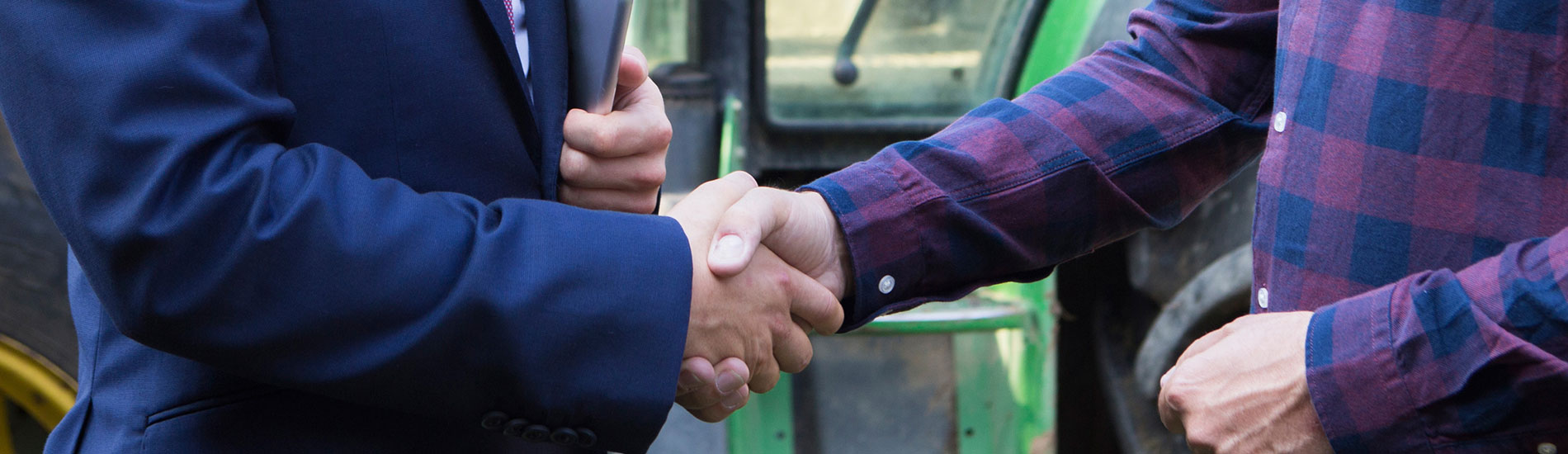 close-up of two men shaking hands