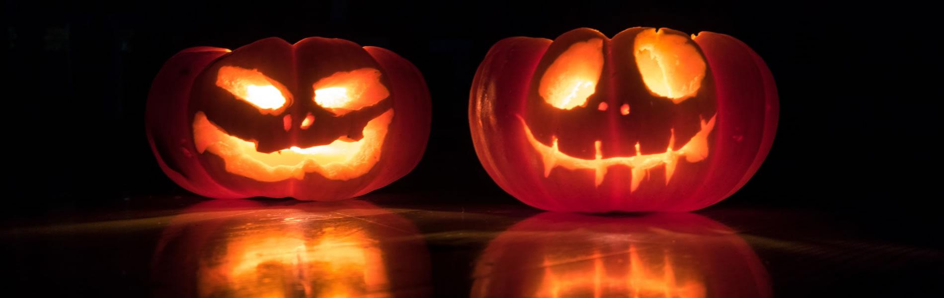 Two jack-o-lanterns illuminated from the inside